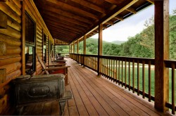 Front porch on cabin with 4 rocking chairs