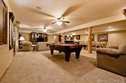 Downstairs living area with pool table image 1